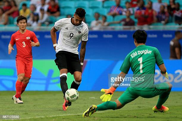 Davie Selke of Germany scores Germany's second goal past Dongjun Kim of Korea during a Men's First Round Group C football match between Germany and...