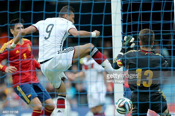 Davie Selke of Germany scores his team's first goal past goalkeeper Ruben Blanco of Spain during the UEFA Under 19 Elite Round match between U19...
