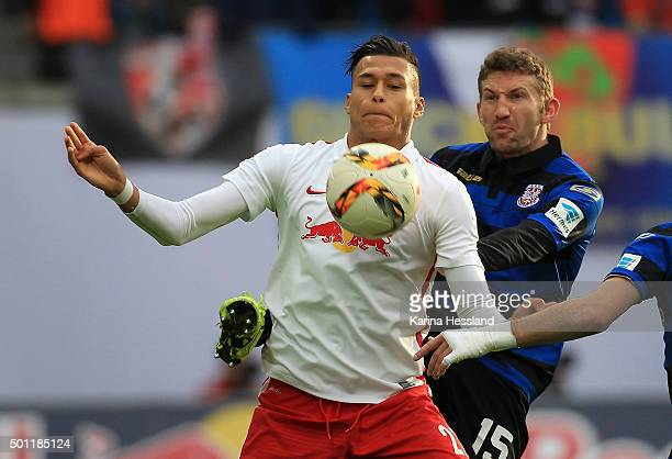 Davie Selke of Leipzig is challenged by Alexander Huber of Frankfurt during the Second League match between RB Leipzig and FSV Frankfurt at Red Bull...