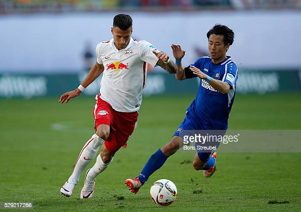 Davie Selke of Leipzig is challenged by Hiroki Yamada of Karlsruhe during the Second Bundesliga match between RB Leipzig and Karlsruher SC at Red...