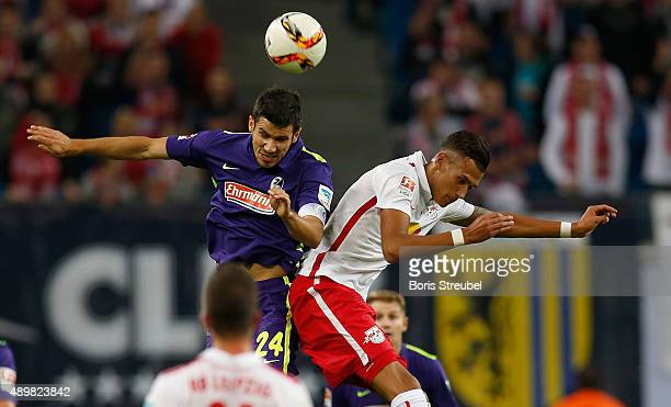 Davie Selke of Leipzig jumps for a header with Mensur Mujdza of Freiburg during the Second Bundesliga match between RB Leipzig and SC Freiburg at Red...