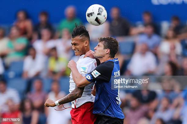 Davie Selke of Leipzig jumps for a header with Pirmin Schwegler of Hoffenheim during the Bundesliga match between TSG 1899 Hoffenheim and RB Leipzig...