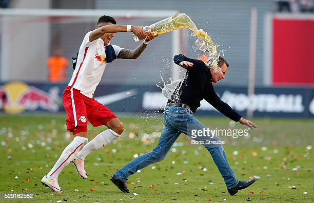 Davie Selke of Leipzig showers his head coach Ralf Rangnick with beer while celebrating promotion to the first Bundesliga after the Second Bundesliga...