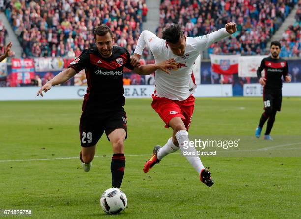 Davie Selke of RB Leipzig battles for the ball with Markus Suttner of FC Ingolstadt 04 during the Bundesliga match between RB Leipzig and FC...