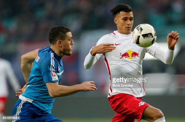 Davie Selke of RB Leipzig is challenged by Kyriakos Papadopoulos of Hamburger SV during the Bundesliga match between RB Leipzig and Hamburger SV at...