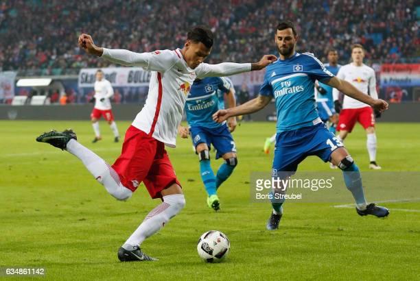 Davie Selke of RB Leipzig is challenged by Mergim Mavraj of Hamburger SV during the Bundesliga match between RB Leipzig and Hamburger SV at Red Bull...