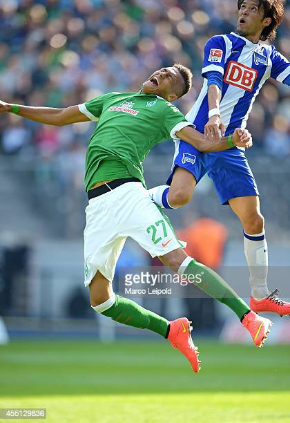 Davie Selke of SV Werder Bremen and Hajime Hosogai of Hertha BSC go up for a header during the Bundesliga match between Hertha BSC and Werder Bremen...