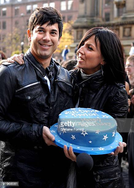 Davina McCall and actor Adam Garcia attend the mass dance routine for the new Sky 1 Just Dance program on October 16 2009 in Manchester England...