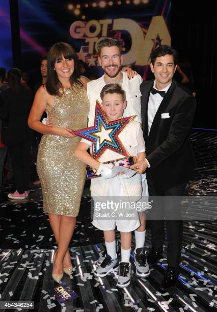 Davina McCall and Adam Garcia pose with 'Duplic8' who were announced as overall winners during the live final of 2014's 'Got To Dance' at Earls Court...