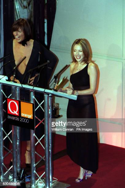 Davina McCall and Kylie Minogue presenting the award for Best Act in the World at the Park Lane Hotel central London for the Q Awards The event...