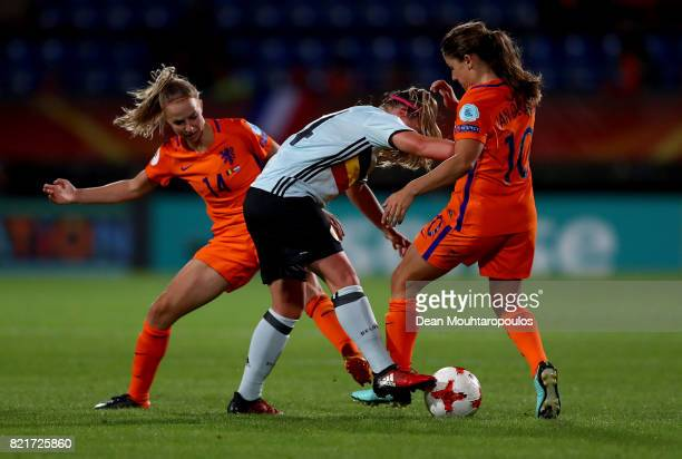 Davinia Vanmechelen of Belgium and Jackie Groenen of Netherlands compete for the ball during the Group A match between Belgium and Netherlands during...