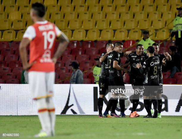 Davinson Monsalve of Once Caldas celebrates with teammates after scoring the second goal of his team during a match between Independiente Santa Fe...