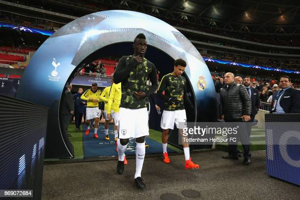 Davinson Sanchez and Dele Alli of Tottenham Hotspur walk out of the tunnel prior to the UEFA Champions League group H match between Tottenham Hotspur...