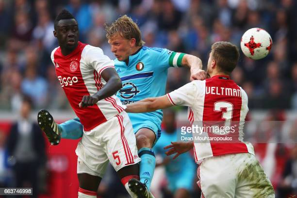 Davinson Sanchez and Joel Veltman of Ajax battles for the ball with Dirk Kuyt of Feyenoord Rotterdam during the Dutch Eredivisie match between Ajax...