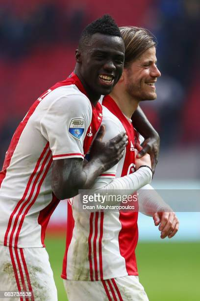 Davinson Sanchez and Lasse Schone of Ajax celebrate victory after the Dutch Eredivisie match between Ajax Amsterdam and Feyenoord at Amsterdam ArenA...