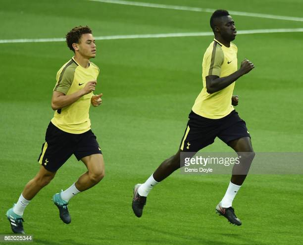 Davinson Sanchez and Luke Amos of Tottenham Hotspur during a Tottenham Hotspur training session ahead of the Champions League Group H match between...