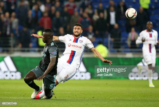 Davinson Sanchez of Ajax Amsterdam and Nabil Fekir of Lyon during the UEFA Europa League semi final second leg match between Olympique Lyonnais and...