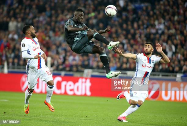 Davinson Sanchez of Ajax Amsterdam between Alexandre Lacazette and Nabil Fekir of Lyon during the UEFA Europa League semi final second leg match...