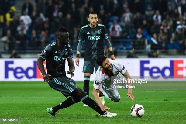 Davinson Sanchez of Ajax commit a fault on Nabil Fekir of Lyon during the Uefa Europa League semi final second leg match between Olympique Lyonnais...