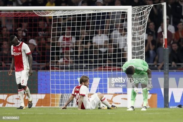 Davinson Sanchez of Ajax Lasse Schone of Ajax goalkeeper Andre Onana of Ajax during the UEFA Champions League third round qualifying first leg match...