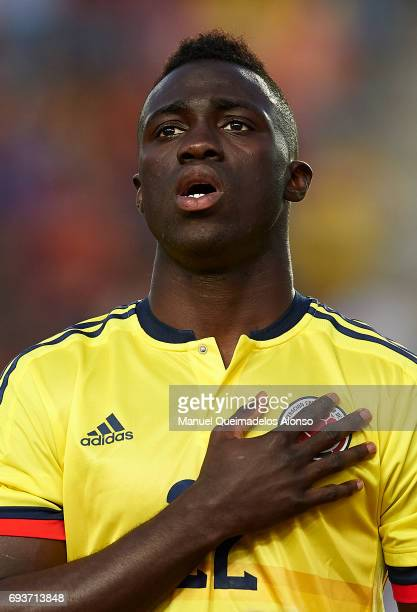 Davinson Sanchez of Colombia stands for their national athem prior to the international friendly match between Spain and Colombia at Nueva Condomina...