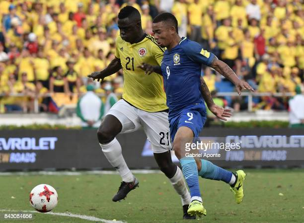 Davinson Sanchez of Colombia struggles for the ball with Gabriel Jesus of Brazil during a match between Colombia and Brazil as part of FIFA 2018...