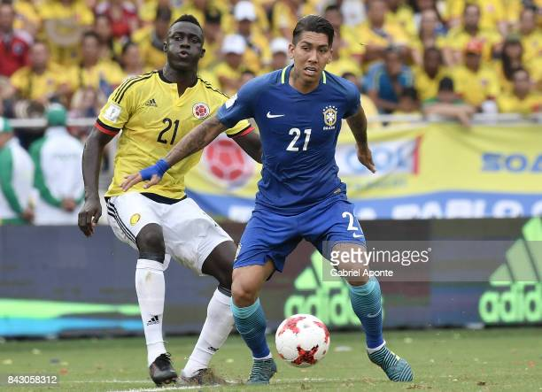 Davinson Sanchez of Colombia struggles for the ball with Roberto Firmino of Brazil during a match between Colombia and Brazil as part of FIFA 2018...