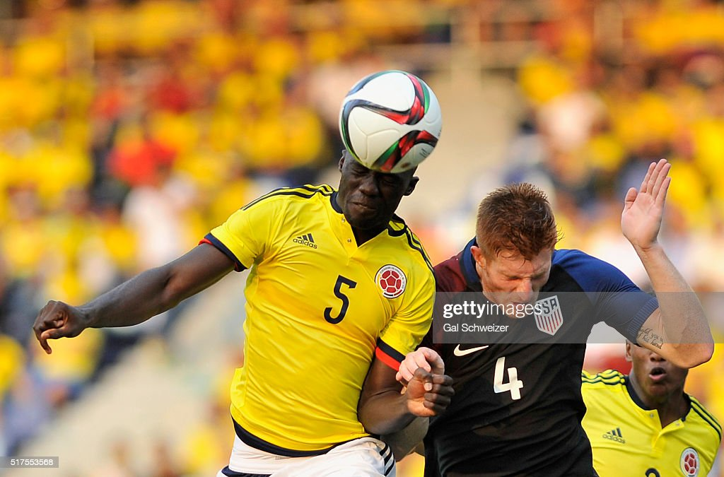 Davinson Sanchez (L) of Colombia struggles for the ball with Tim Parker (R) of US during a U-23 Olympic Qualifying Playoff match between Colombia and USA at Metropolitano Roberto Melendez Stadium on March 25, 2016 in Barranquilla, Colombia.