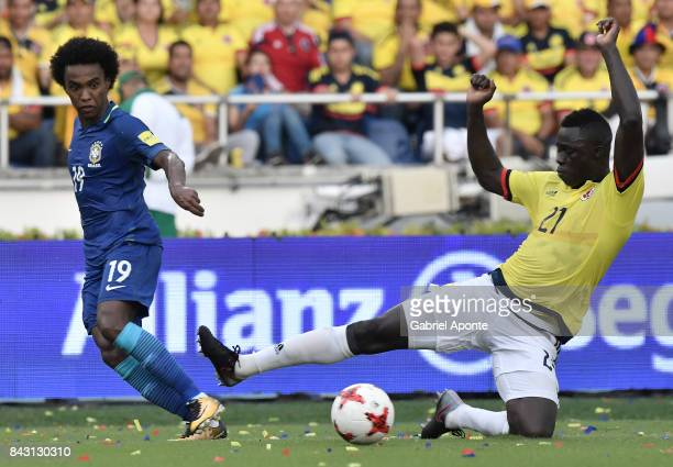 Davinson Sanchez of Colombia struggles for the ball with Willian of Brazil during a match between Colombia and Brazil as part of FIFA 2018 World Cup...