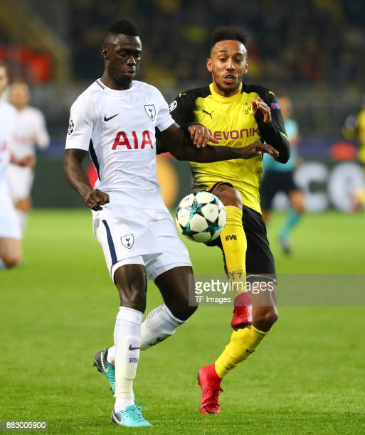 Davinson Sanchez of Tottenham and PierreEmerick Aubameyang of Dortmund battle for the ball during the UEFA Champions League group H match between...