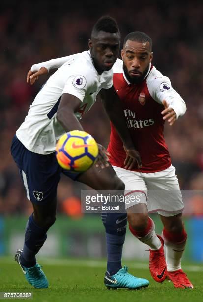 Davinson Sanchez of Tottenham Hotspur and Alexandre Lacazette of ArsenArsenal battle for possession during the Premier League match between Arsenal...