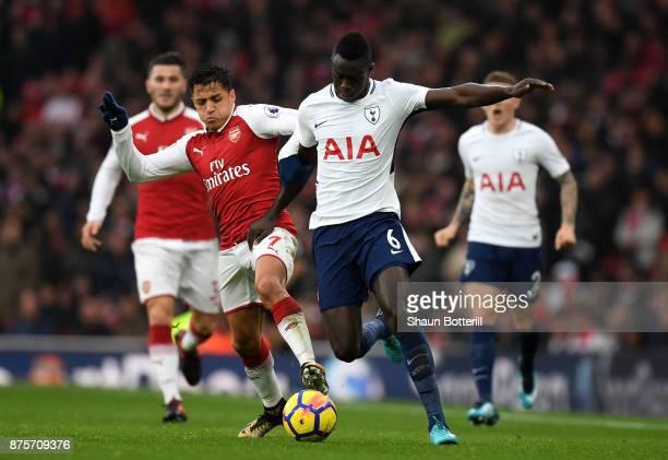 Davinson Sanchez of Tottenham Hotspur and Alexis Sanchez of Arsenal battle for possession during the Premier League match between Arsenal and...