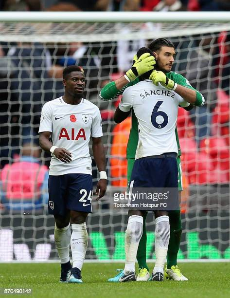 Davinson Sanchez of Tottenham Hotspur and Paulo Gazzaniga of Tottenham Hotspur embrace after the Premier League match between Tottenham Hotspur and...
