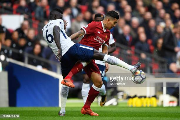 Davinson Sanchez of Tottenham Hotspur and Roberto Firmino of Liverpool battle for possession during the Premier League match between Tottenham...