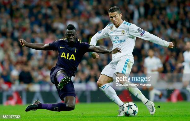 Davinson Sanchez of Tottenham Hotspur attempts to tackle Cristiano Ronaldo of Real Madrid during the UEFA Champions League group H match between Real...