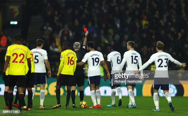 Davinson Sanchez of Tottenham Hotspur is shown a red card by referee Martin Atkinson during the Premier League match between Watford and Tottenham...