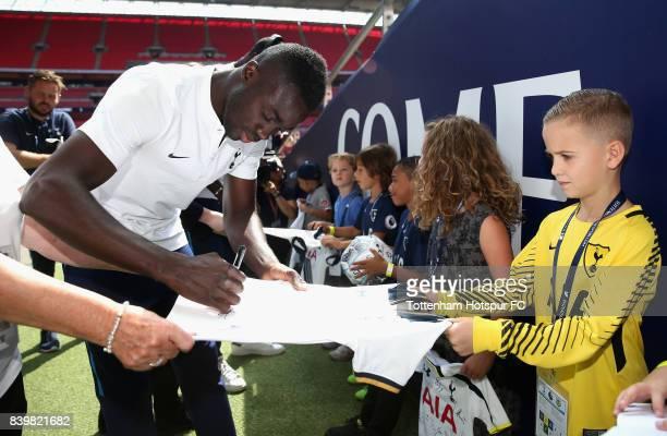 Davinson Sanchez of Tottenham Hotspur signs autographs as he arrives at the stadium prior to the Premier League match between Tottenham Hotspur and...