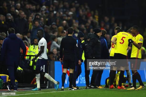 Davinson Sanchez of Tottenham Hotspur walks off after being sent off during the Premier League match between Watford and Tottenham Hotspur at...