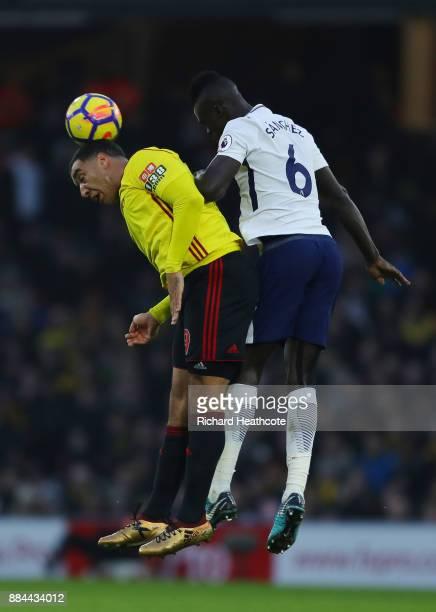 Davinson Sanchez of Tottenham Hotspur wins a header over Troy Deeney of Watford during the Premier League match between Watford and Tottenham Hotspur...