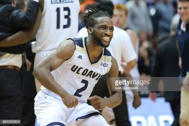 Davis Aggies guard Darius Graham celebrates after UC David defeats Cal State Fullerton in overtime with no time remaining in the game between the Cal...