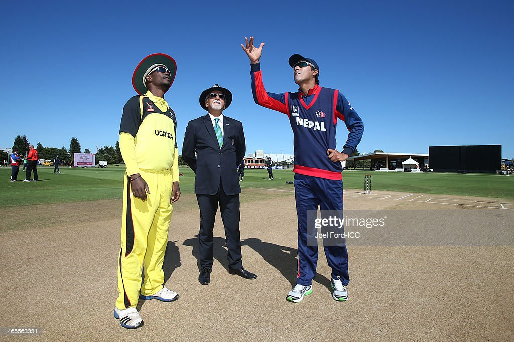 Davis Arinaitwe Karashani captain of Uganda, match referee Dev Govindjee and Nepal captain Paras Khadka during the coin toss prior to an ICC World Cup qualifying playoff between Uganda and Nepal on January 28, 2014 in Mount Maunganui, New Zealand.