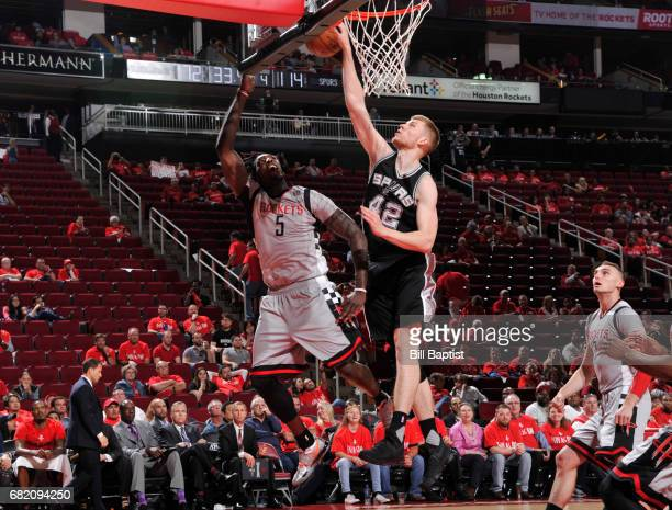 Davis Bertans of the San Antonio Spurs blocks a shot against the Houston Rockets during Game Six of the Western Conference Semifinals of the 2017 NBA...