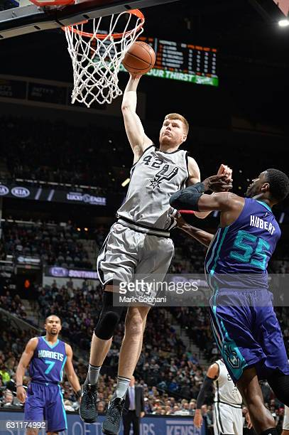 Davis Bertans of the San Antonio Spurs dunks against the Charlotte Hornets on January 7 2017 at the ATT Center in San Antonio Texas NOTE TO USER User...