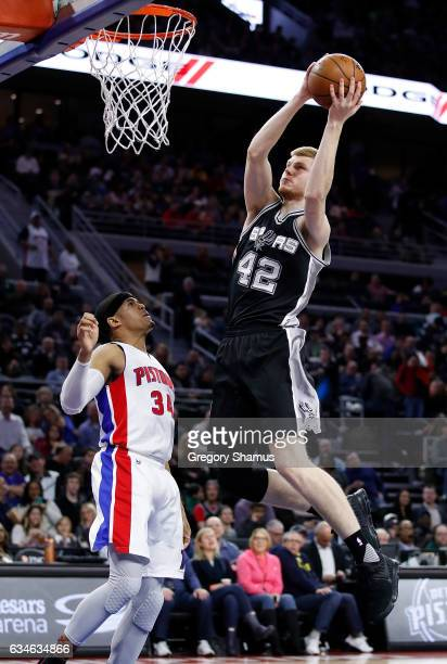 Davis Bertans of the San Antonio Spurs gets to the basket past Tobias Harris of the Detroit Pistons during the second half at the Palace of Auburn...