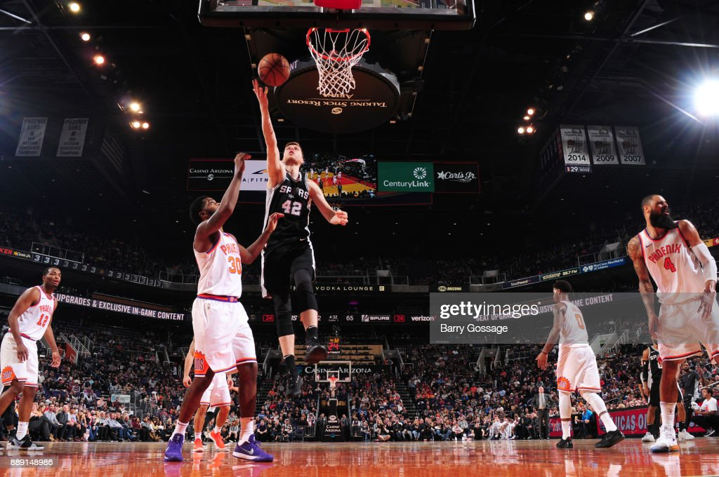 Davis Bertans #42 of the San Antonio Spurs goes for a lay up against the Phoenix Suns on December 9, 2017 at Talking Stick Resort Arena in Phoenix, Arizona.