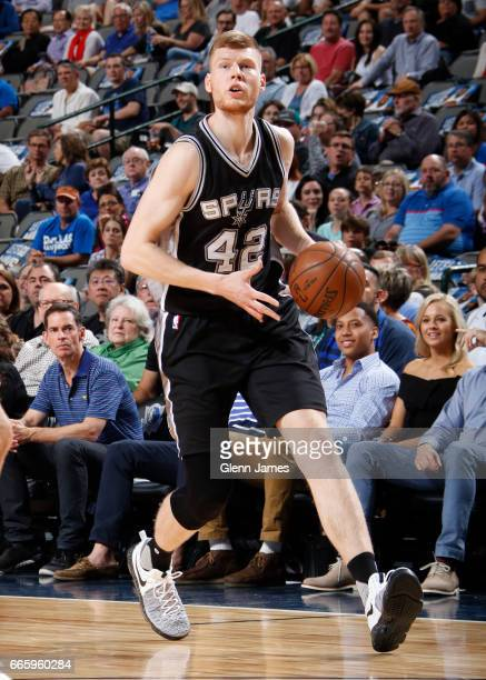 Davis Bertans of the San Antonio Spurs handles the ball against the Dallas Mavericks during the game on April 7 2017 at the American Airlines Center...