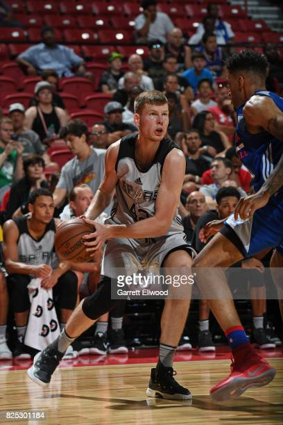 Davis Bertans of the San Antonio Spurs handles the ball during the game against the Philadelphia 76ers during the 2017 Las Vegas Summer League on...