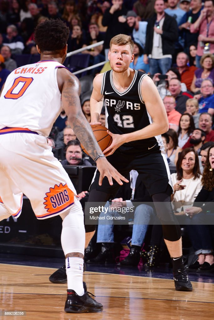 Davis Bertans #42 of the San Antonio Spurs looks to pass the ball against the Phoenix Suns on December 9, 2017 at Talking Stick Resort Arena in Phoenix, Arizona.