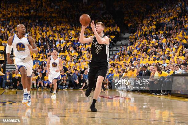 Davis Bertans of the San Antonio Spurs passes the ball against the Golden State Warriors during Game Two of the Western Conference Finals of the 2017...