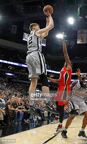 Davis Bertans of the San Antonio Spurs shoots a three during game between New Orleans Pelicans and the San Antonio Spurs at ATT Center on October 29...